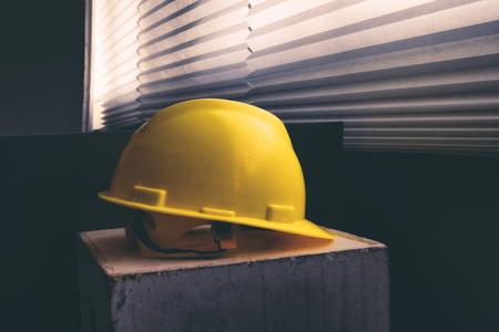 Yellow safety helmet shot under low light