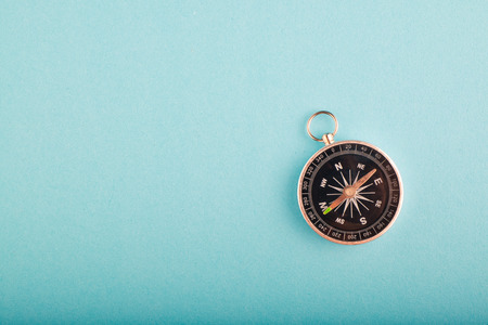 compass on blue background for travel or direction concept.copy space for text
