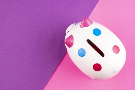 financial crisis concept, empty piggy bank on pastel color background. copy space for text