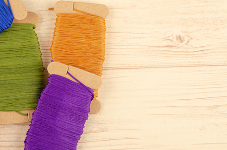 colorful stacking cotton yarn wool on wooden background. copy space for text Reklamní fotografie