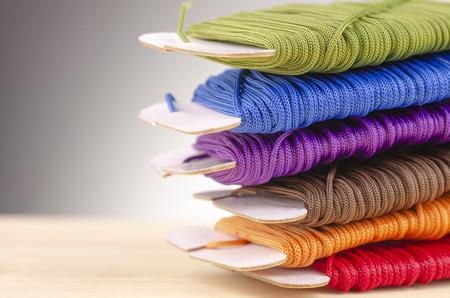 colorful stacking cotton yarn wool over beautiful reverberation gradient background.