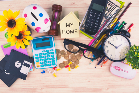 flat lay top view shot, scattered home office workspace or desk concept with accessories and stationery