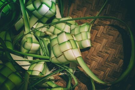 Ketupat (rice dumpling) casing is made from young coconut leaves. It is a local delicacy during the festive season in South East Asia