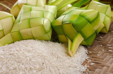 ketupat casing and rice in bamboo container. traditional malay delicacy during Malaysian eid festival Imagens