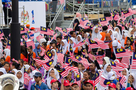 KUALA LUMPUR, MALAYSIA - 29 August 2017 :Crowd waving Malaysian Jalur Gemilang flag during the full rehearsal for Malaysian Independence Day celebration. Editorial
