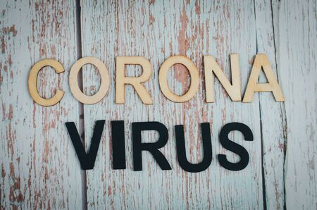 CORONA VIRUS words on wooden background 版權商用圖片