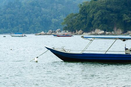 group of speed boat for island hoping activities moored on the Nipah Bay pangkor Island, Malaysia