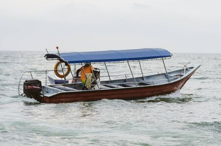 speed boat for island hoping activities moored on the Nipah Bay pangkor Island, Malaysia 免版税图像