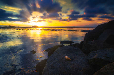Long exposure seascape and rocky beach against sunset background. Nature composition with Soft and grain effect 版權商用圖片