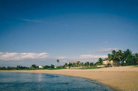 Peaceful view, traditional fihserman village near the seashore againts blue sky and cloudy sky 版權商用圖片