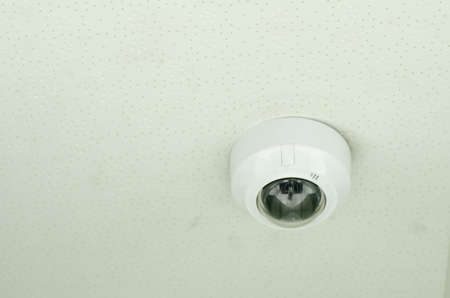 Concept of surveillance and monitoring, modern cctv camera attach to the wall 版權商用圖片