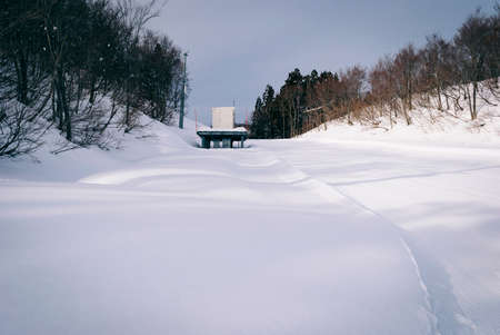 white snow and beautiful landscape during winter season in Japan against blue sky background