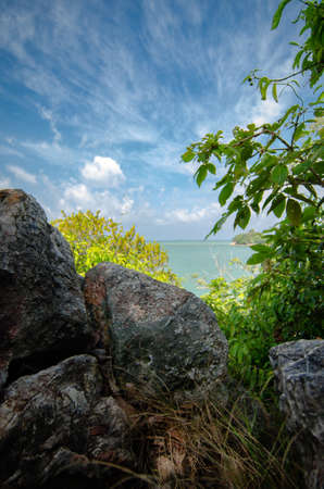 beauty in nature, tropical seashore view from hill top, under bright sunny day and cloudy sky Stock Photo