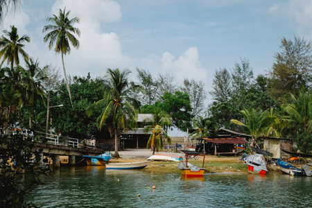 Traditional fishing village located in Terengganu, Malaysia under blue sky background Stock Photo - 153781442