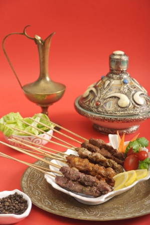 Assorted meat satay dish served in a Mediterranean setting photo