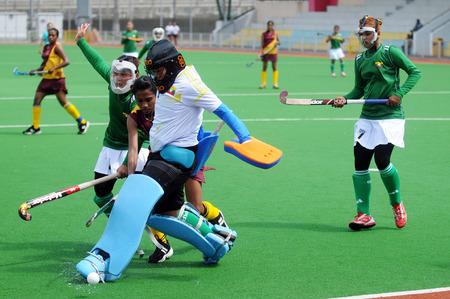Singapore, Singapore - June 25, 2014 - Action during an International women s field hockey match between the Pakistan and Myanmar