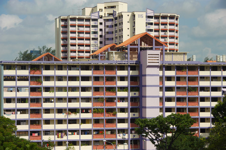 hdb: Singapore, Singapore - Feb 05, 2015 - New and old Singapore public housing (HDB) in the same estate taken in the day on Feb 05, 2015