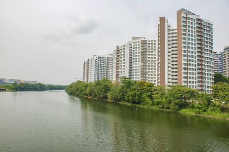 public housing: Singapore - September 25, 2015: Public Housing along river bank