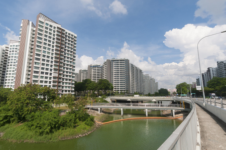 Singapore - May 18, 2016: Public Housing along river bank