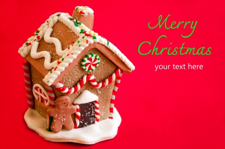 Gingerbread house on red background  photo