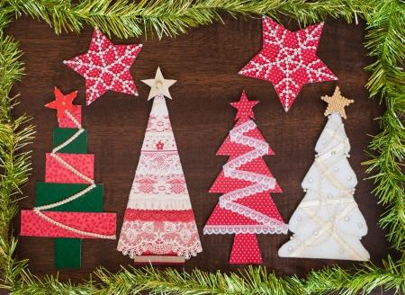 Handmade fabric Christmas tree on wooden background