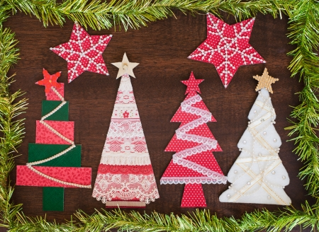 craft background: Handmade fabric Christmas tree on wooden background