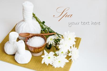 herbal massage ball: Spa still life with exfoliation salt scrub and herbal massage ball