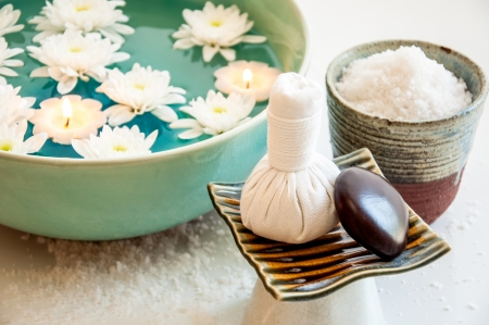 herbal massage ball: Relaxation Spa Concept  Spa still life with exfoliation salt scrub and herbal massage ball