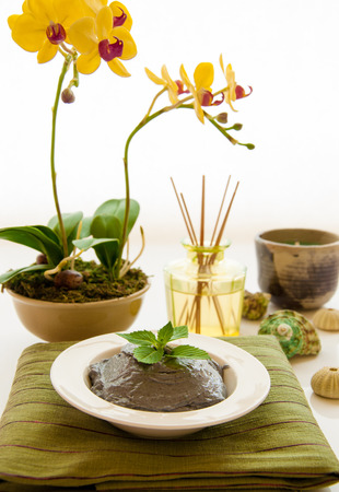 Spa still life with organic scrub with aromatherapy bottle and reeds and orchid flower  photo