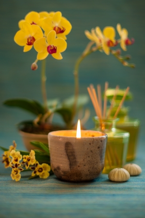 Candle with orchid flower in relaxing spa scene  photo