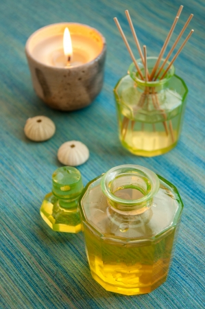 Aromatic essence oil bottle with bottle of fragrance reeds diffuser and candle  photo