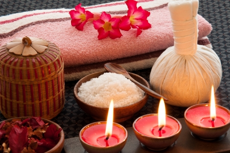 herbal massage ball: Spa still life with herbal massage ball, exfoliation salt scrub and spa accessories  Stock Photo
