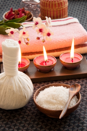 herbal massage ball: Spa still life with exfoliation salt scrub, herbal massage ball and spa accessories