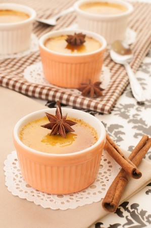 Creme brulee desserts garnished with a star aniseed  photo