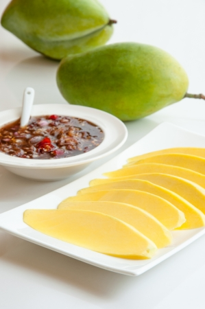fishy: Green mangoes dipped into a sweet fishy paste with dried shrimp and red onions