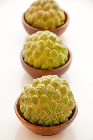 custard apples: Three custard apples on white background  Stock Photo
