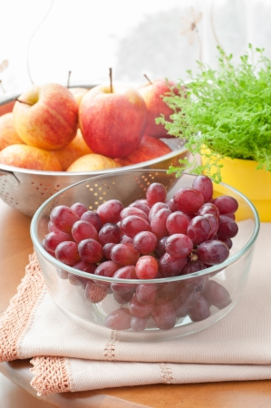 Autumnal organic ripe fruits, red grape and apples on kitchen table. Stock Photo - 23332790