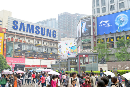 bustling: shopping at downtown area of chengdu,china.This street is named ChunXi road which is the most bustling area of west of china.Photo is taken on 16 April 2011.