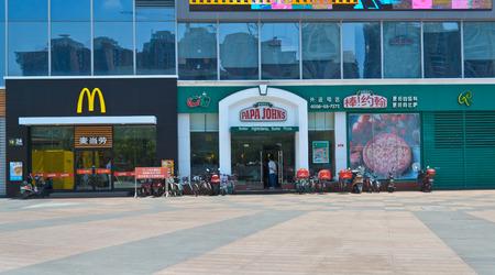 papa johns and McDonalds  service at chengdu,china.Photo is taken on 12 Jun 2011.