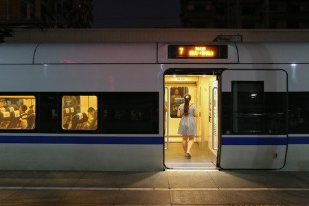 hurrying: CHENGDU,CHINA - Aug 1,2014: people ride new dredge chinese high speed train at night. Editorial