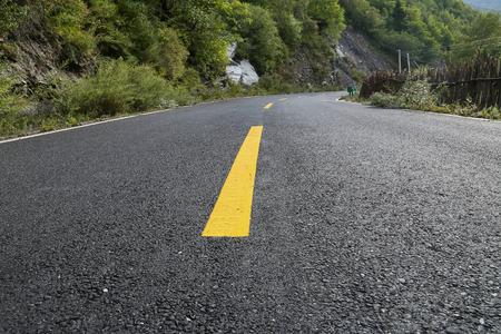 asphalt road with yellow line Reklamní fotografie