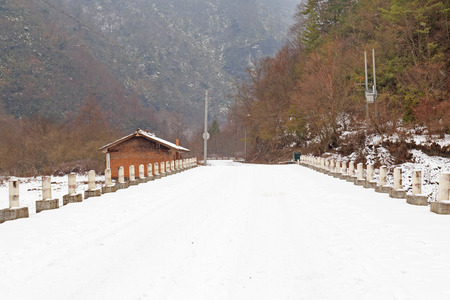 snow road to the house in mountain photo