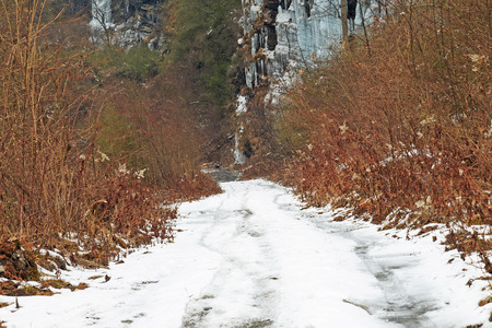 hiking road with snow in mountain photo