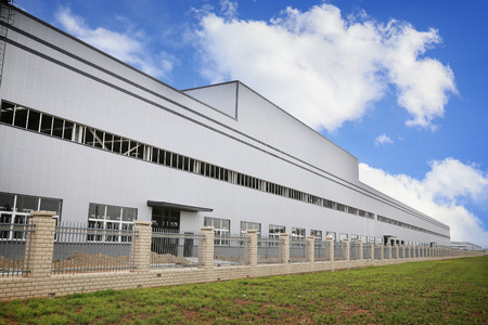 commercial architecture: white modern factory building