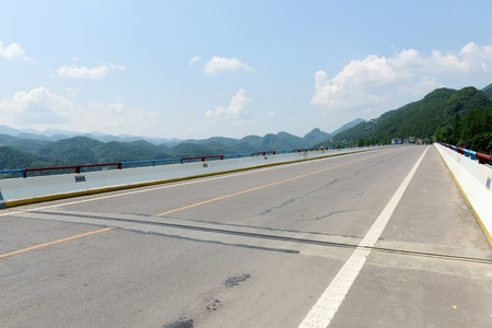 Chinese country road pavement under blue sky and white clouds Reklamní fotografie