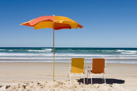 Beach umbrella and two chairs at the beach