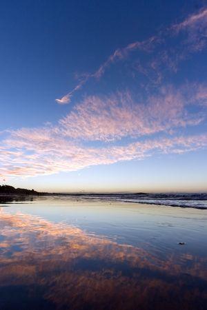 composure: Mirror beach at sunset Stock Photo