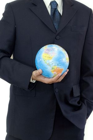 Confident businessman with a globe photo