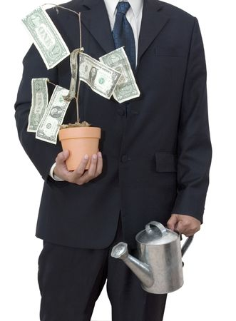 Isolated businessman with his money tree and watering can photo