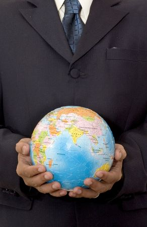 Businessman holding a Globe Puzzle with two hands photo